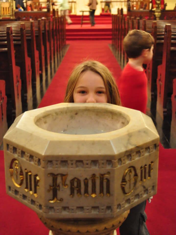 child at the baptismal font