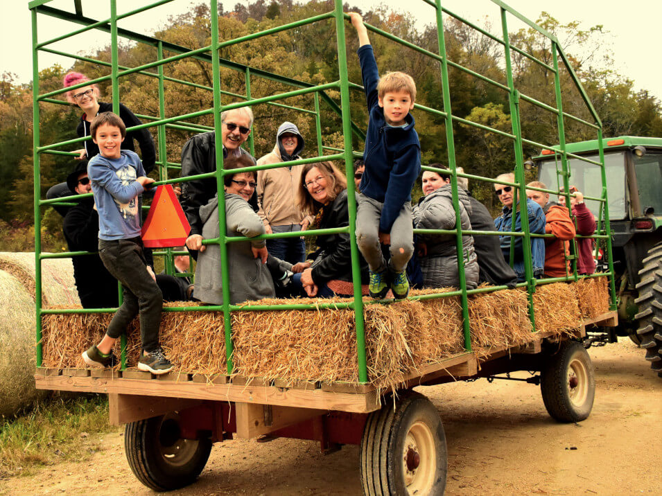 children and families on a hayride